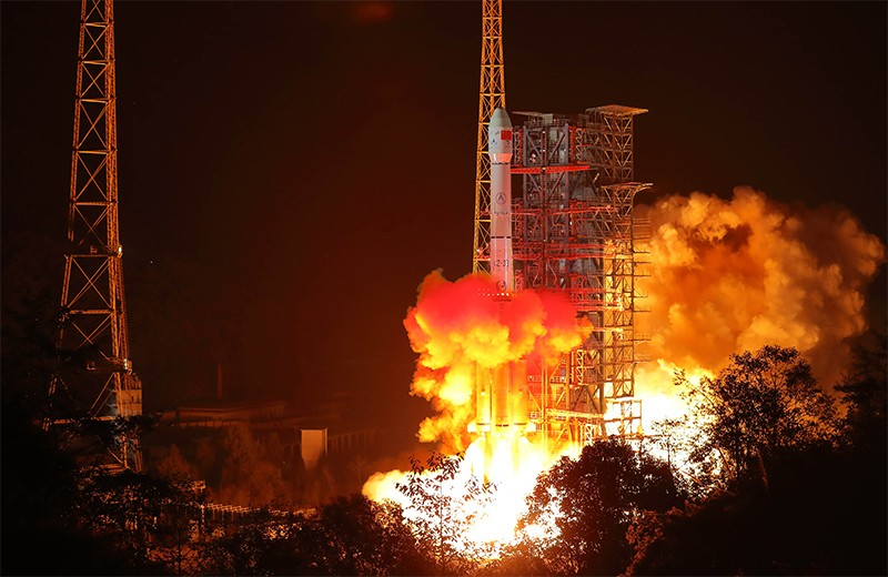 A Long March-3B rocket blasting off in the early morning darkness carrying China's CHang'e-4 lunar probe