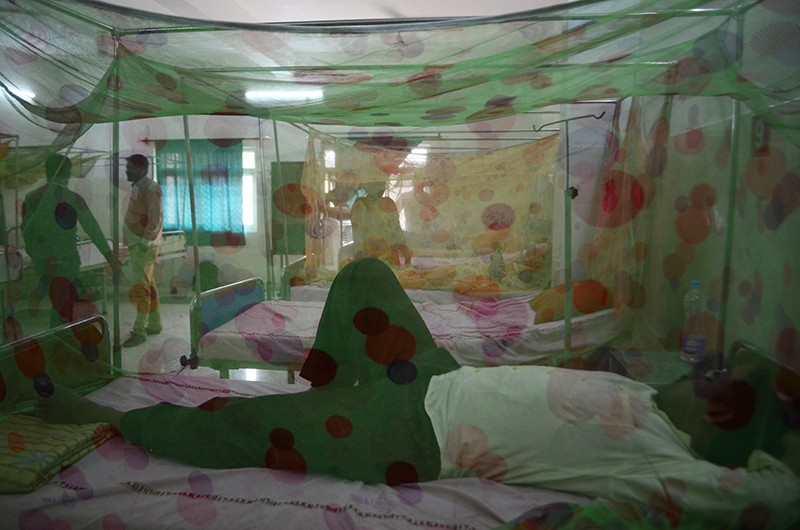 Indian patients suffering from dengue fever in a hospital ward