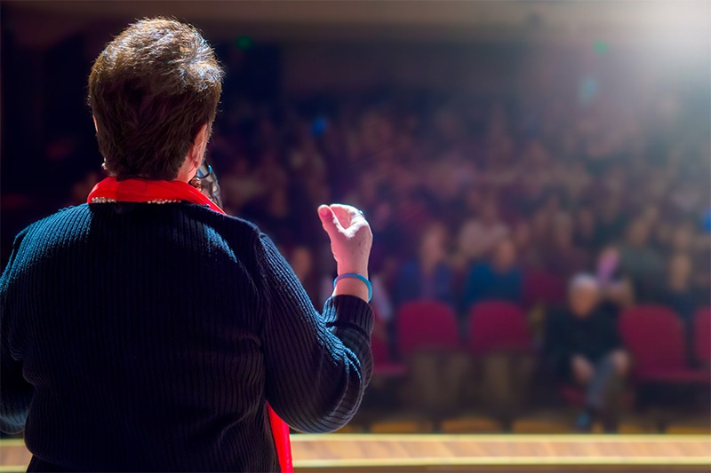 A person giving a talk at a conference