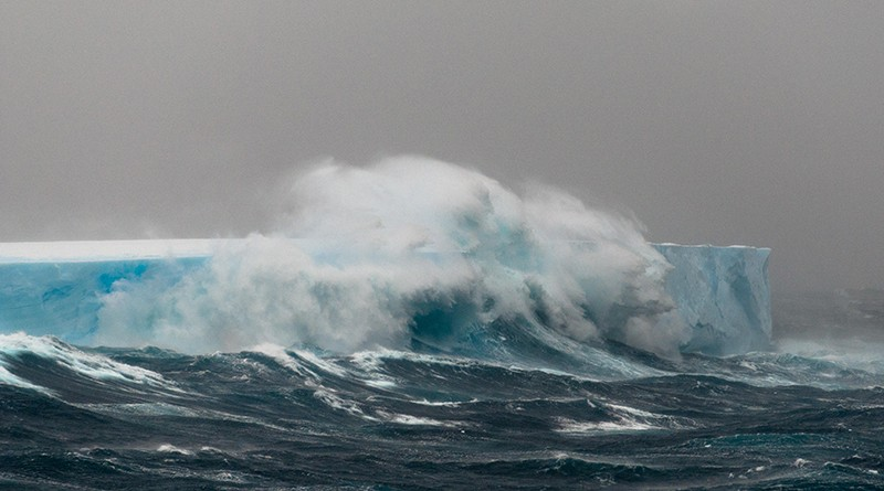 Wave breaking over an iceberg, Southern Ocean, Antarctica
