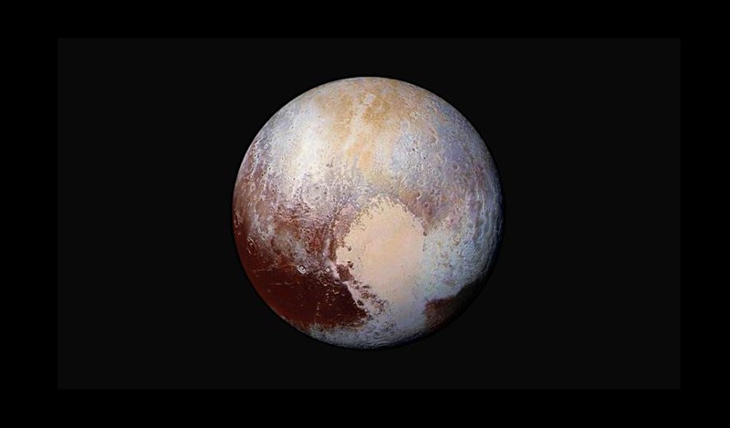 Four images from NASA's New Horizons' LORRI were combined with colour data from RALPH to create this image of Pluto