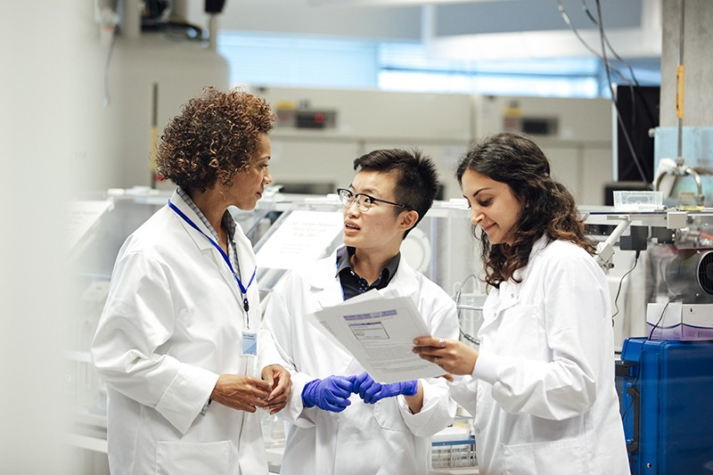 Scientists in a disease research facility