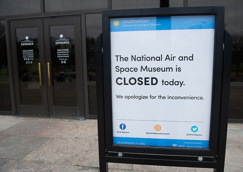 "A ""closed"" sign outside the Smithsonian National Air and Space Museum"