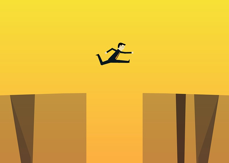 Person jumping over a pitfall