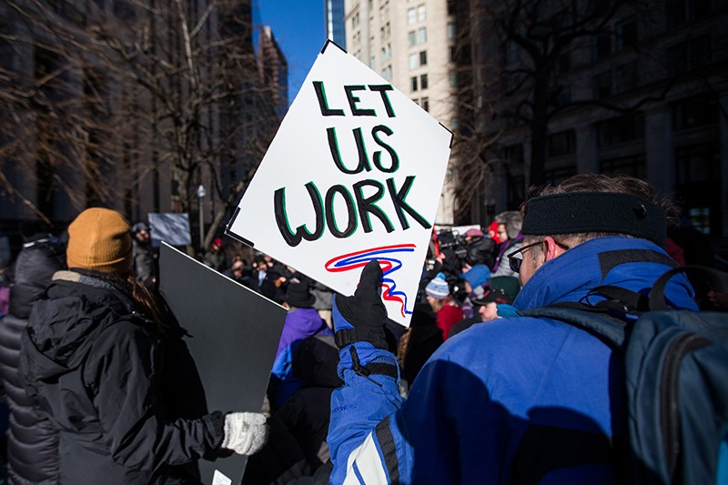 Government workers rally to end the U.S. government shutdown