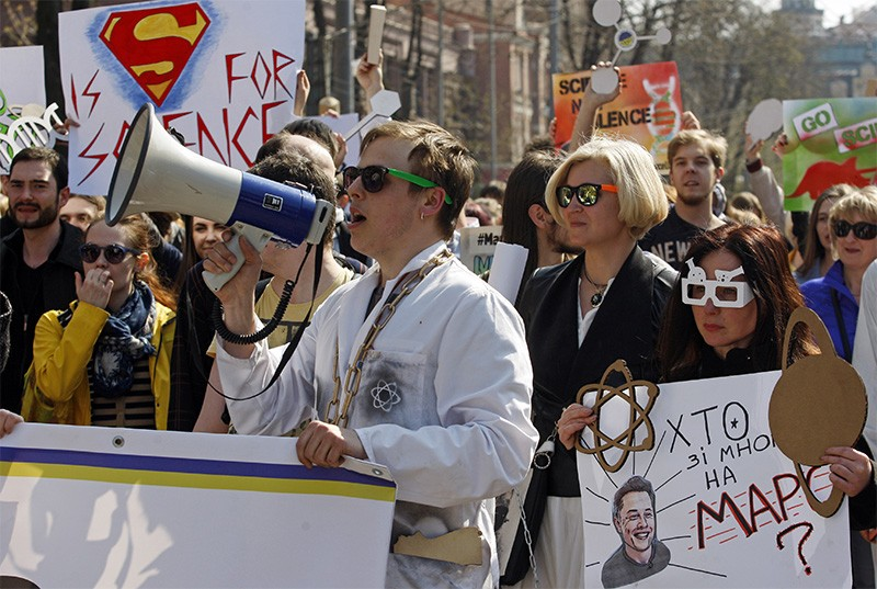 People carry pro-science placards during a March for Science rally in Kiev, Ukraine, in April 2018.
