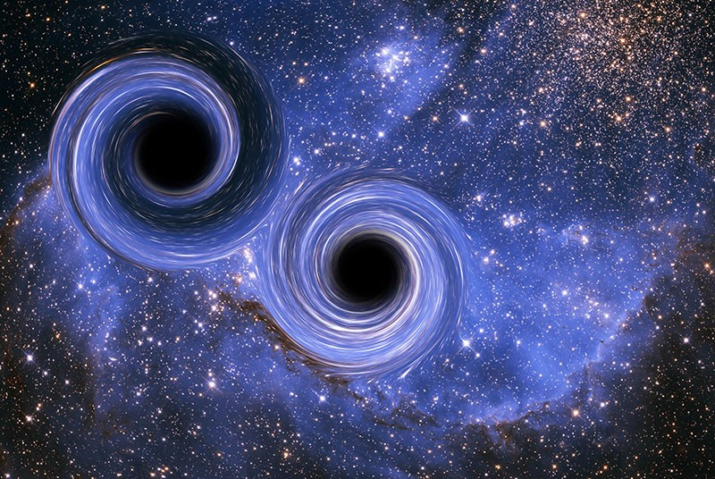 The merger of two black holes, a phenomenon that creates gravitational waves.