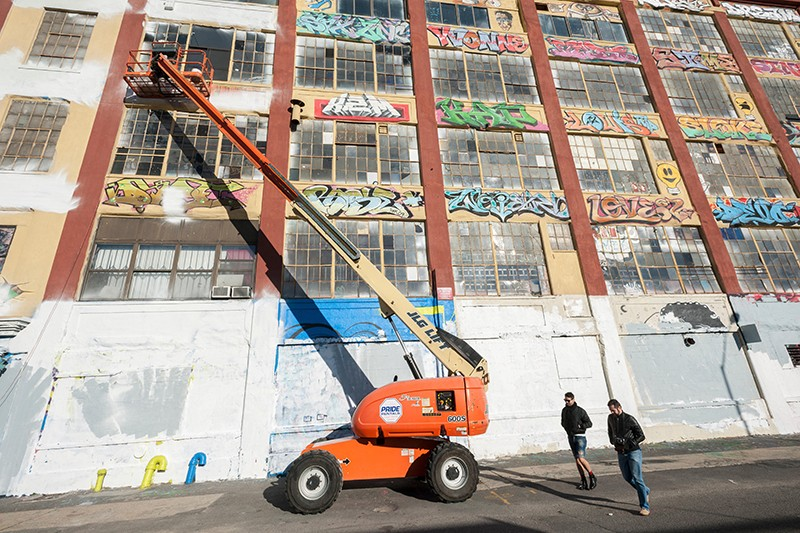 Graffiti removal at The Five Pointz building in New York City.
