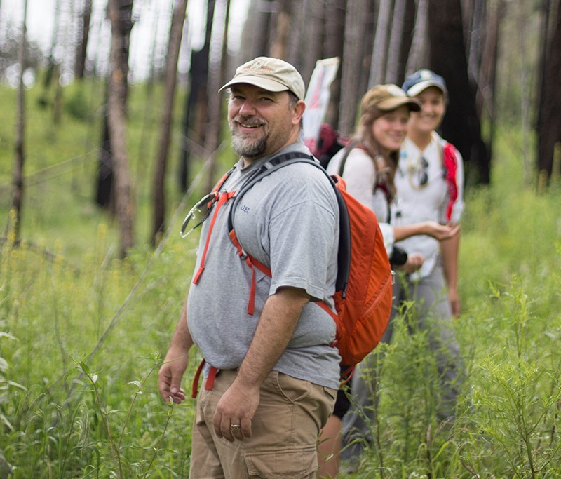 Terry McGlynn smiling while instructing participants in fieldwork collecting ants for Southwestern Research Portal