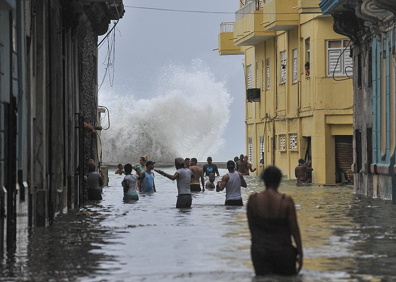 Cubans wade through a flooded street in Havana after Hurricane Irma in 2017.