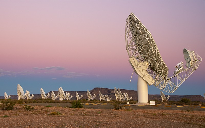 MeerKAT-3 dish array under a setting sun in South Africa, SARAO