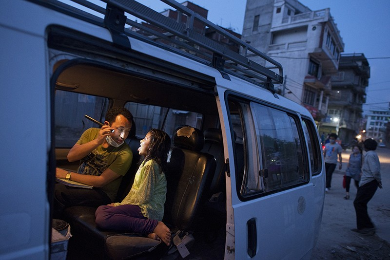 A mobile clinic van helps to support medical checks of homeless youth in Kathmandu, Nepal