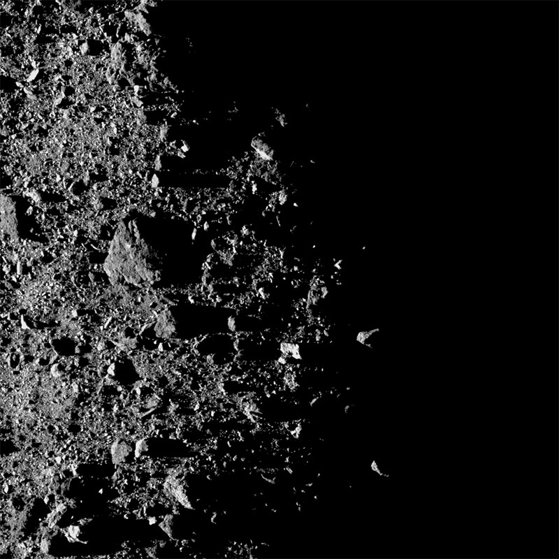 Rocky surface of asteroid Bennu's north pole region showing the day and night terminator line on February 20th 20193