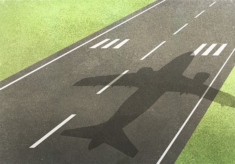 Illustration of a shadow of a plane on a runway