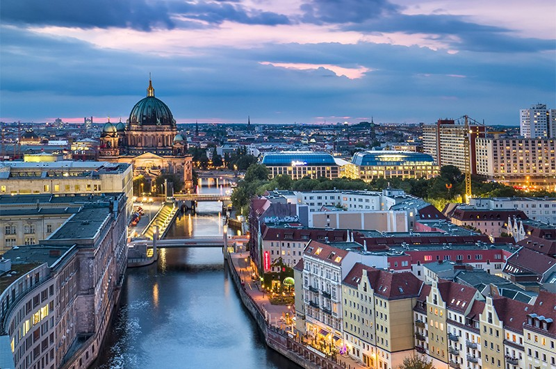 Cityscape Showing Berlin Cathedral And A River At Night