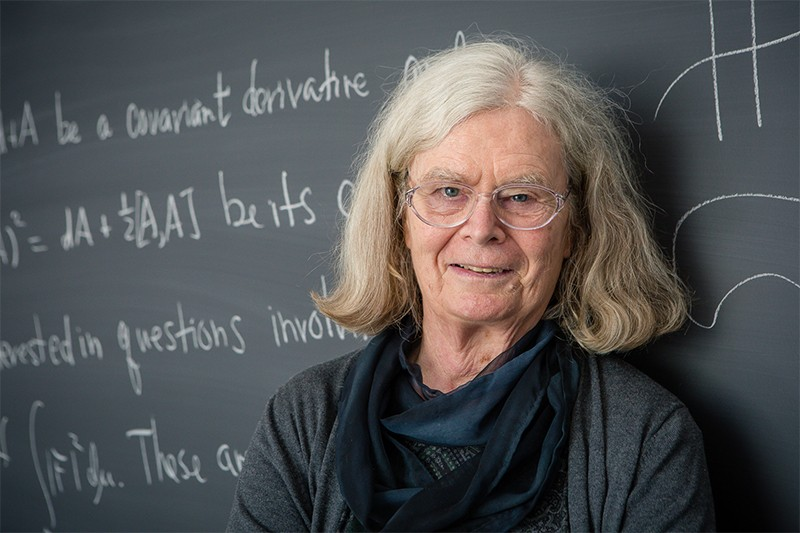 Karen Keskulla Uhlenbeck, winner of the Abel prize, photographed in front of a blackboard