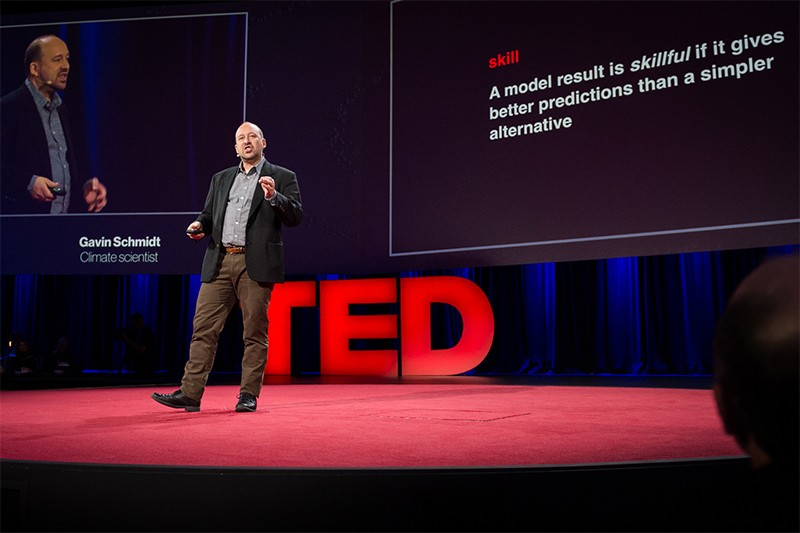 Gavin Schmidt paces in front of screens during a TED presentation in Canada in 2014