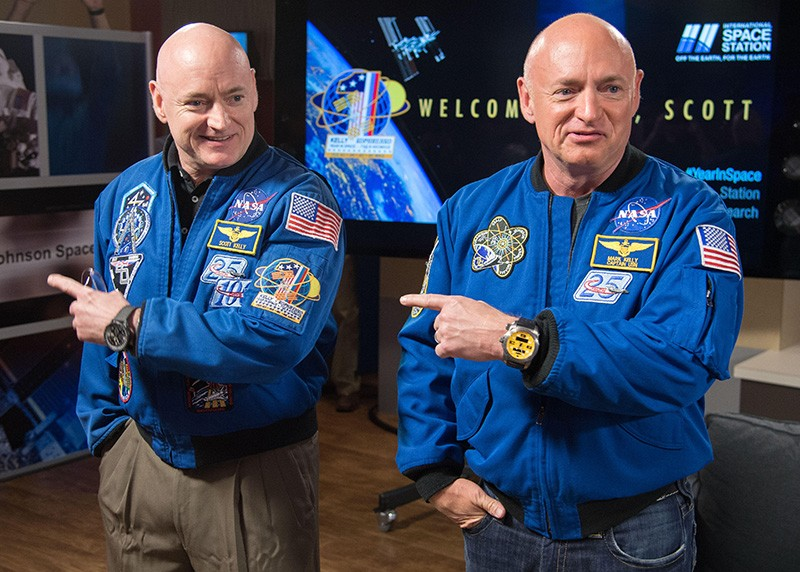 NASA astronauts Scott Kelly, left, with his twin brother, Mark Kelly