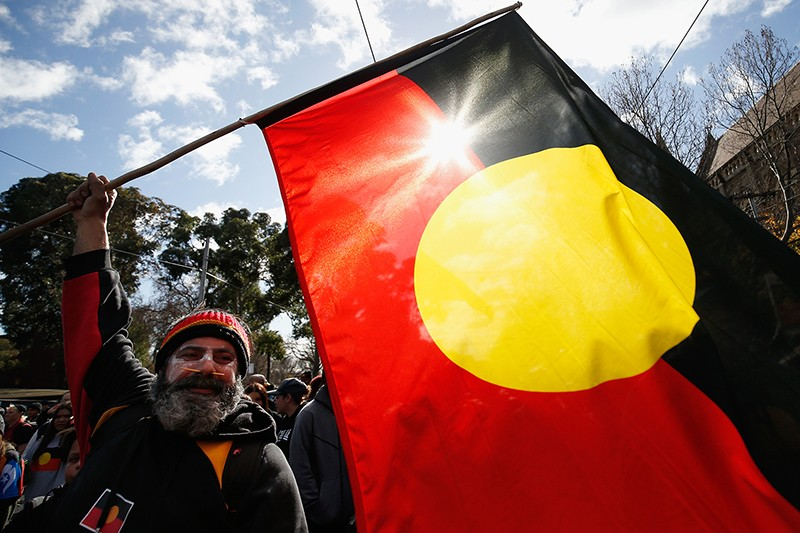 A flag is waved in celebration to celebrate the history, culture and achievements of Aboriginal peoples in Australia.