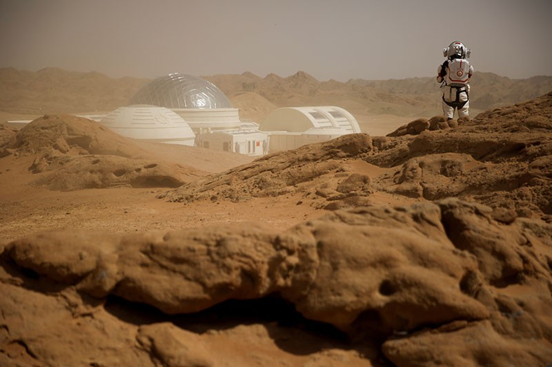 One person in a space suit at the Mars simulation base of the C-Space project.
