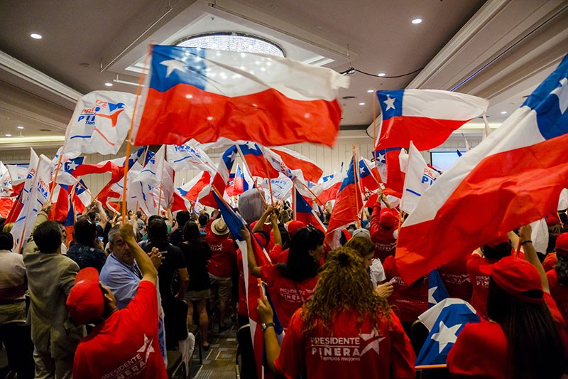 Supporters of Presidential Candidate Sebastian Piñera wave flags in Santiago, Chile