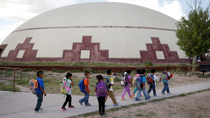 Students walk between school buildings in Birdsprings, Ariz. on the Navajo Nation.