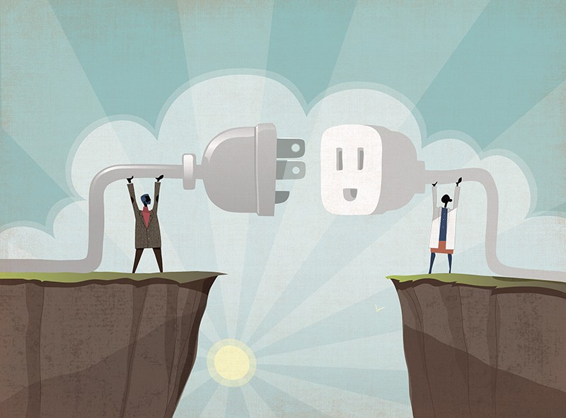 Businessman and scientist connecting plug across divide