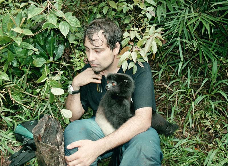 Alex Dehgan holding a Milne-Edwards' Sifaka in Madagascar