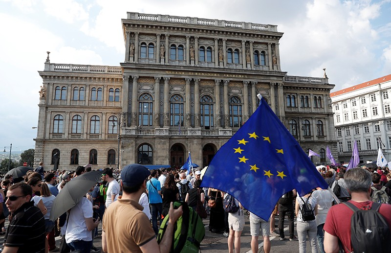 People protest outside the Hungarian Academy of Sciences against government's plans to overhaul the institution in Budapest