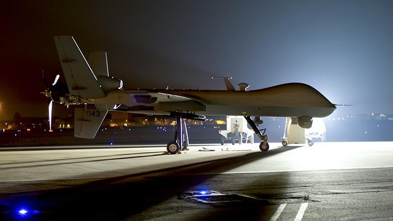 An MQ-9 Reaper sits on the flight line at Hurlburt Field with mounted surveillance equipment