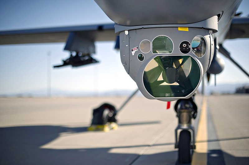 A remotely piloted MQ-9 Reaper aircraft with surveillance system