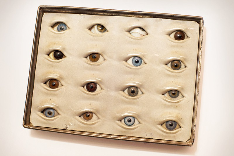A box containing glass eyes with irises of various colours.