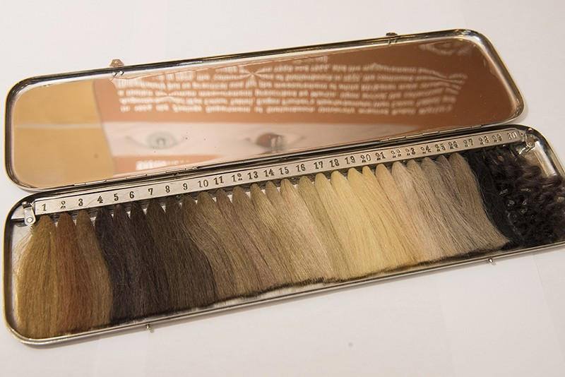 A box containing tufts of hair of various colours.