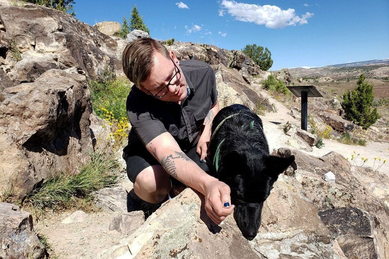 Riley Black and their dog Jet on site in Colorado