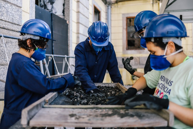 Student volunteers work at the National Museum in Rio de Janeiro sifting through the rubble to recover artefacts