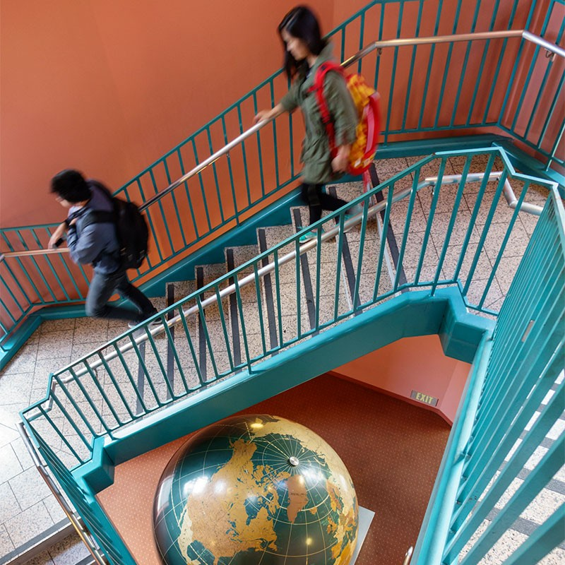 Students descending the stairs at Leavey Library.
