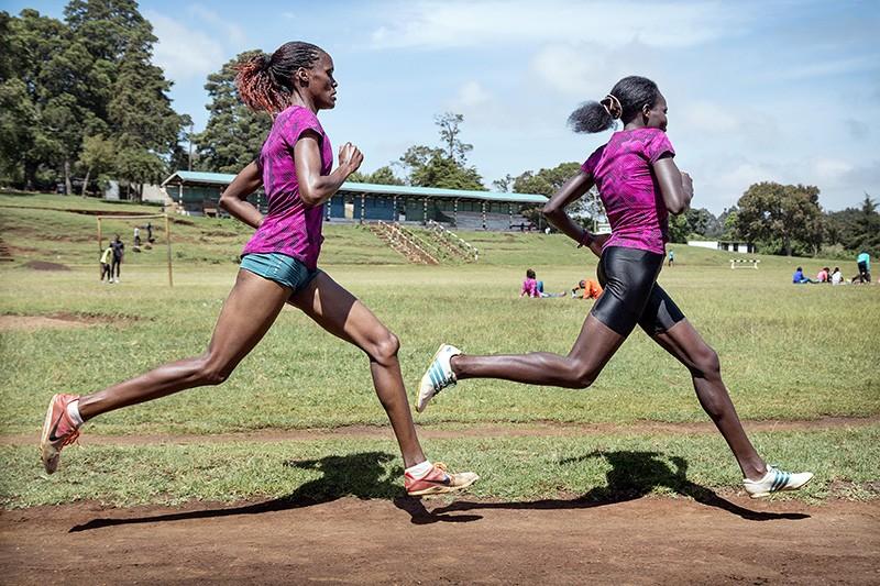 Female athletes training on a running track in Iten, Kenya