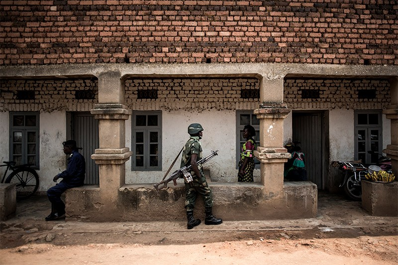 A member of the Government forces patrols near a health centre in Butembo.
