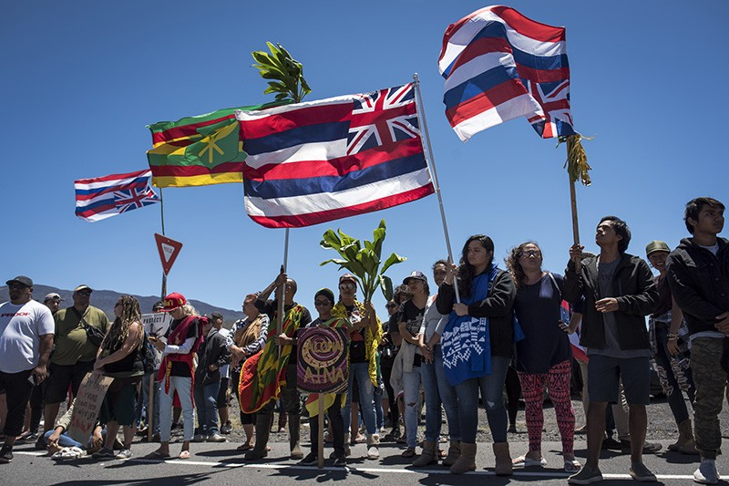 Hundreds of demonstrators gathered by the Mauna Kea Access Road in Hawaii