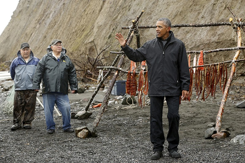 Barack Obama delivers brief remarks after meeting traditional fishers on the shore of the Nushagak River in Dillingham, Alaska