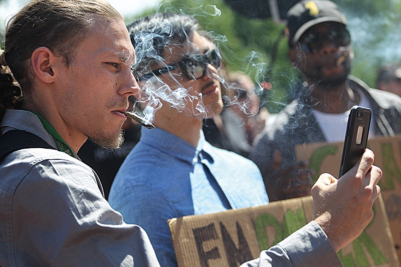 Campaigners smoke cannabis at a rally in Boston, Massachusetts
