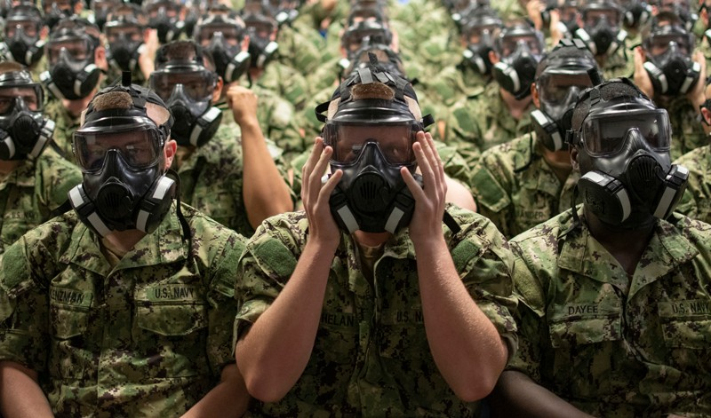 U.S. Navy recruits test their personal protective equipment