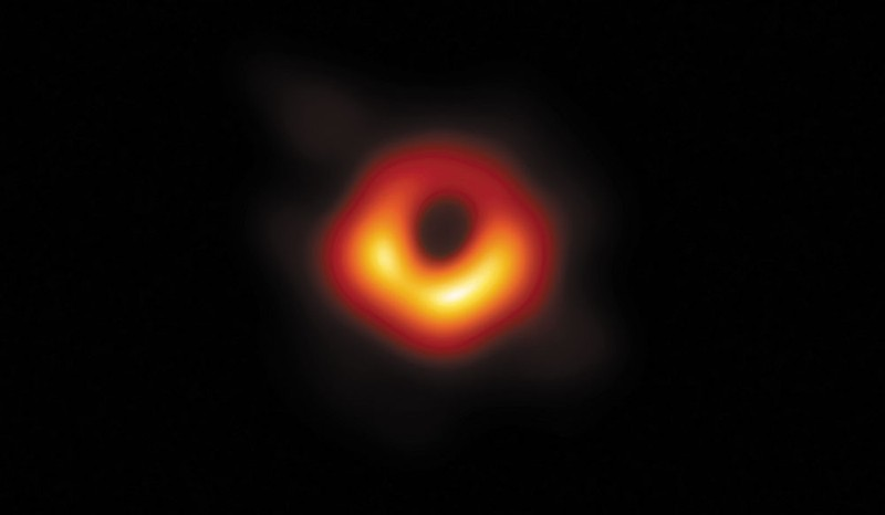 A glowing orange ring on a black background.