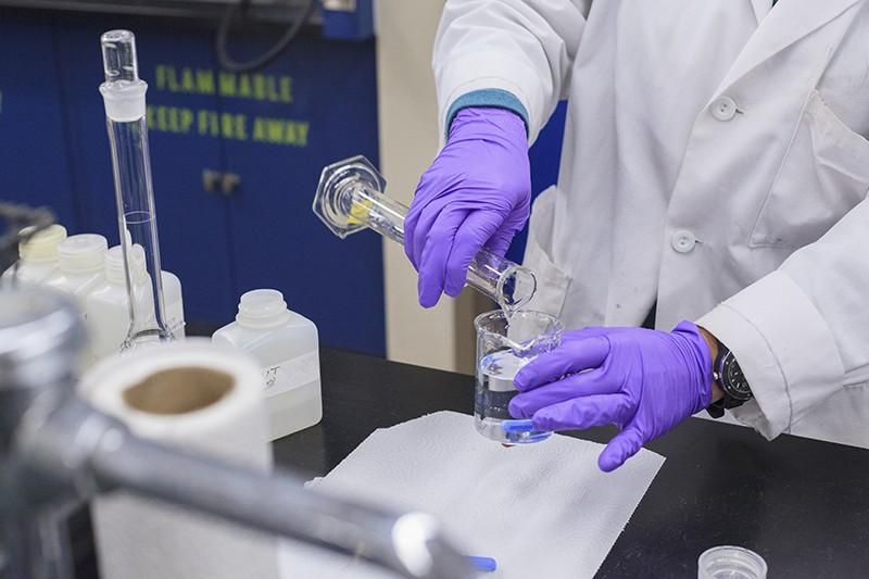Closeup of a laboratory technician mixing reagents.