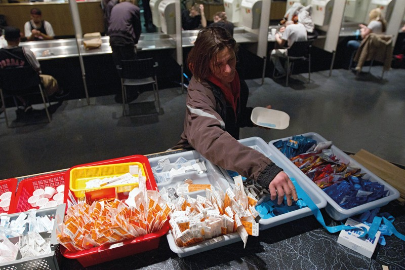 A client at the supervised injection site Insite in Vancouver, Canada, collects her kit.