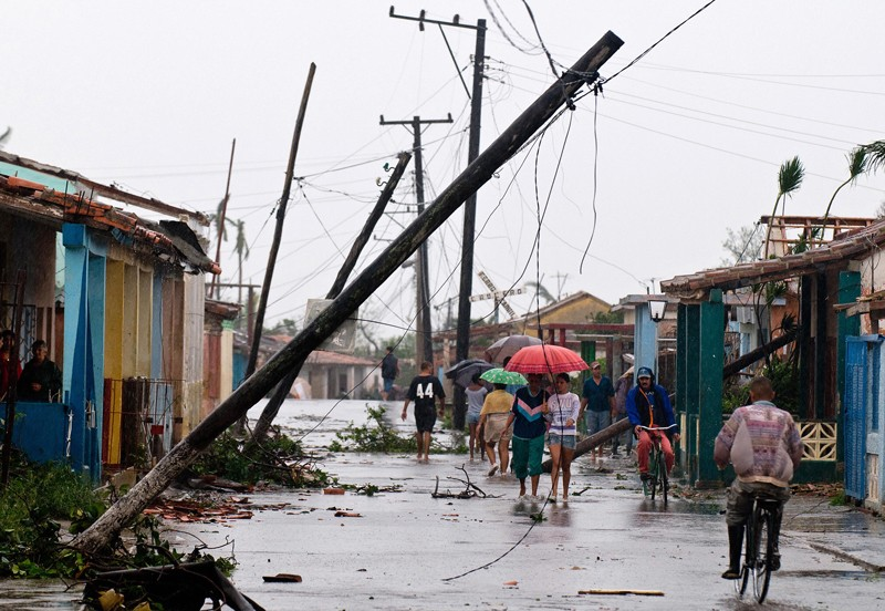 Locals walk in a damaged street after Hurricane Gustav in Pinar del Rio province,100 km west of Havana