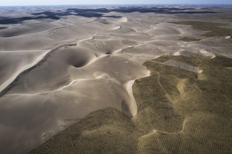 The view of planted trees in desert are seen from an aircraft on March 28th, 2019 in Wuwei, Gansu Province.