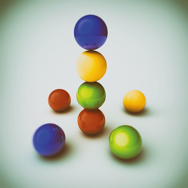 Artistic image of coloured balls stacked on top of one another