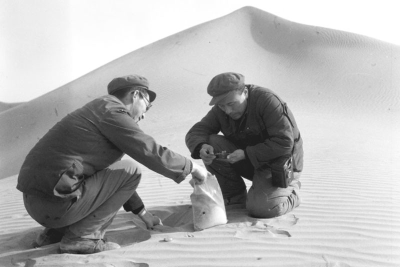 Chinese Academy of Science researchers take sand samples in northwest China's Lop Nur Desert.