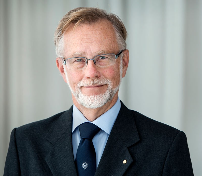 Göran Hansson, in a dark jacket and tie, photographed from the shoulders up.